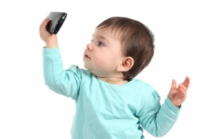 4280580-baby-watching-a-mobile-phone